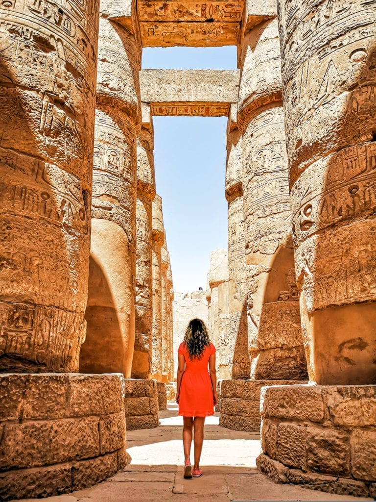 Walking through the impressive columns of the Karnak Temple - Luxor